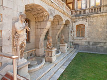 Sculptures in Massandra palace in Crimea. Sculptures in Massandra palace - satyres and chimeras Stock Photos