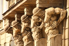 Sculptures on old building stock photos