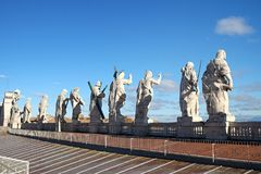 Sculptures on the pediment of St. Peter`s Cathedral. In the Vatican. View from the roof Stock Photo