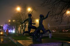 Sculptures on Pobediteley Avenue in foggy weather stock photos