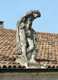 Sculptures on the roof with red tiles Stock Photography