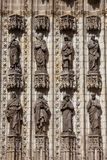 Sculptures of Saints on Seville Cathedral Facade Stock Image