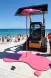 Sculptures by the Sea: Backhoe Dripping in Pink Stock Photos