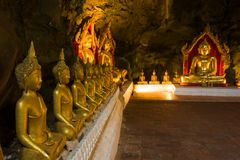 Sculptures of a Buddha in the old cave temple of Wat Tham Khao Luang. Phetchaburi, Thailand. Sculptures of a seated Buddha in the old cave temple of Wat Tham royalty free stock images