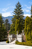 Sculptures and staircase in the garden of Peles Castle, Romania Royalty Free Stock Photo