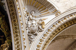 Sculptures in the temple. The gilded fresco in the Spanish church Stock Images