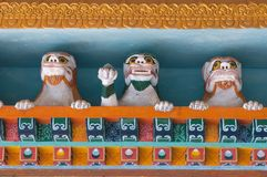 Sculptures of three stone snow lions among Tibetan ornaments in Buddhist monastery, Sikkim, India. Sculptures of three stone snow lions among Tibetan ornaments Stock Photos