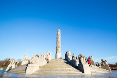 Sculptures at the Vigeland Park. OSLO NORWAY- JANUARY 1: Visitors enjoying the statues created by Gustav Vigeland in the popular Vigeland park in Oslo, Norway on Royalty Free Stock Photo