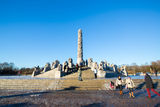 Sculptures at the Vigeland Park. OSLO NORWAY- JANUARY 1: Visitors enjoying the statues created by Gustav Vigeland in the popular Vigeland park in Oslo, Norway on Royalty Free Stock Images