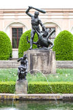 Sculptures in Wallenstein Gardens  Valdstejnska zahrada. In the background is the palace Wallenstein first baroque palace in Pragu Royalty Free Stock Images