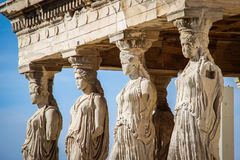 Sculptures of women in the temple complex Acropolis in Athens royalty free stock photography