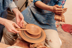 Sculpturing the clay pot Stock Photography
