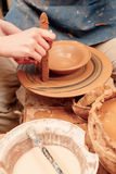 Sculpturing the clay pot Royalty Free Stock Images