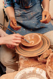 Sculpturing the clay pot Stock Images