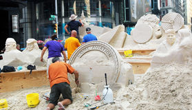Sculpturing in sand. Artists creating sand sculptures in times square during fleet week Royalty Free Stock Photo