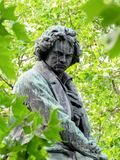 Ludwig van Beethoven monument Vienna. Sculpure of the important composer and pianist Ludwig van Beethoven in Vienna - green tree in the background Royalty Free Stock Photography