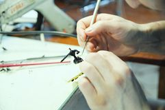 Scultor at work. young man sculpting handmade toy bee from plastic glue, house decoration craftsmanship hobby, decor creation. Scultor at work. young man stock images