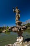Scultura del giovane in fontana dell'isola, giardini di Boboli, Italia Fotografia Stock