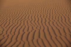 Scultura della sabbia sul deserto Fotografia Stock Libera da Diritti