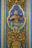 Scultura di altorilievo dell'angelo o del mito del fronte del cavallo su ceramico e fotografia stock libera da diritti