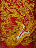 Scultura di bassorilievo in tempie buddisti Tailandia Immagini Stock Libere da Diritti
