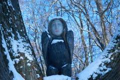 Scultura di legno dell'uccello con la testa del ` s della donna Immagine Stock