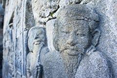 Scultura di pietra sulla parete di Borobudur Immagine Stock Libera da Diritti