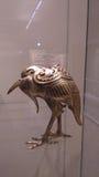 Scultura dorata dell'uccello Fotografie Stock