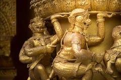 Scultura dorata della scimmia Fotografia Stock