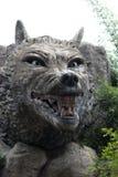 Scultura grigia di pietra della lupo-pietra Fotografie Stock Libere da Diritti