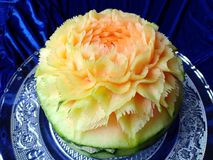 Scultura originale tailandese creativa della frutta del melone del cantalupo bella Immagini Stock