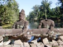 Sculture antiche all'ponti Angkor Wat/Cambogia Immagini Stock Libere da Diritti