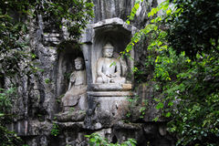 Sculture buddisti in Feilai Feng Caves Immagini Stock Libere da Diritti