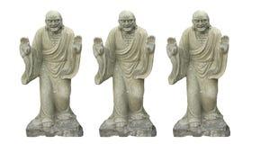 Sculture budista chino antiguo tres aislado en los fondos blancos imagenes de archivo
