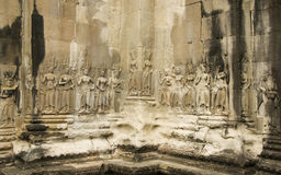 Sculture di Devata, Angkor Wat, Cambogia fotografie stock libere da diritti