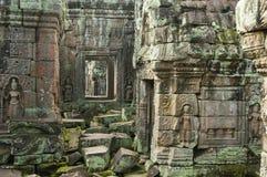 Sculture di pietra di Devata, tempio di Preah Kahn, Cambogia fotografie stock libere da diritti