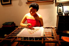 Thai lady in the past. Sculture of thai lady dress in the past and do their art work with concentration Royalty Free Stock Image