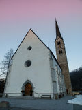 Scuol church in winter time evening Stock Photos