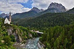 Scuol-view of the bridge and the church Stock Image