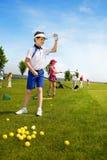 Scuola di golf dei bambini Immagini Stock Libere da Diritti