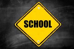 Scuola di parola scritta su un segno di cautela Fotografia Stock Libera da Diritti