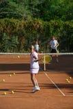 Scuola di tennis Immagini Stock