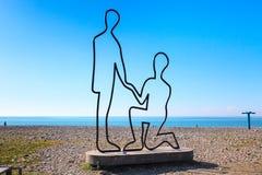 Scuplture dedicated to love on beach along the Black Sea in Batumi, Adjara, Georgia. Batumi, Georgia - April 30, 2017: Scuplture of man and woman in love on the Royalty Free Stock Image
