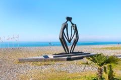 Scuplture dedicated to love on beach along the Black Sea in Batumi, Adjara, Georgia. Batumi, Georgia - April 30, 2017: Scuplture of man and woman in love on the Stock Images