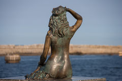 Scuplture of a siren with the sea view Royalty Free Stock Photography