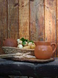 Scuttle of bread and jug. Scuttle of bread , potatoes and parsley Stock Image