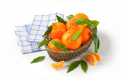 Scuttle of ripe tangerines. And checkered dishtowel on white background Royalty Free Stock Images
