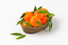 Scuttle of ripe tangerines. On white background Royalty Free Stock Photo