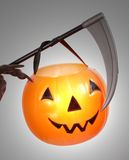 Scythe And Pumpkin Royalty Free Stock Images