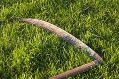 Scythe in grass Stock Photos